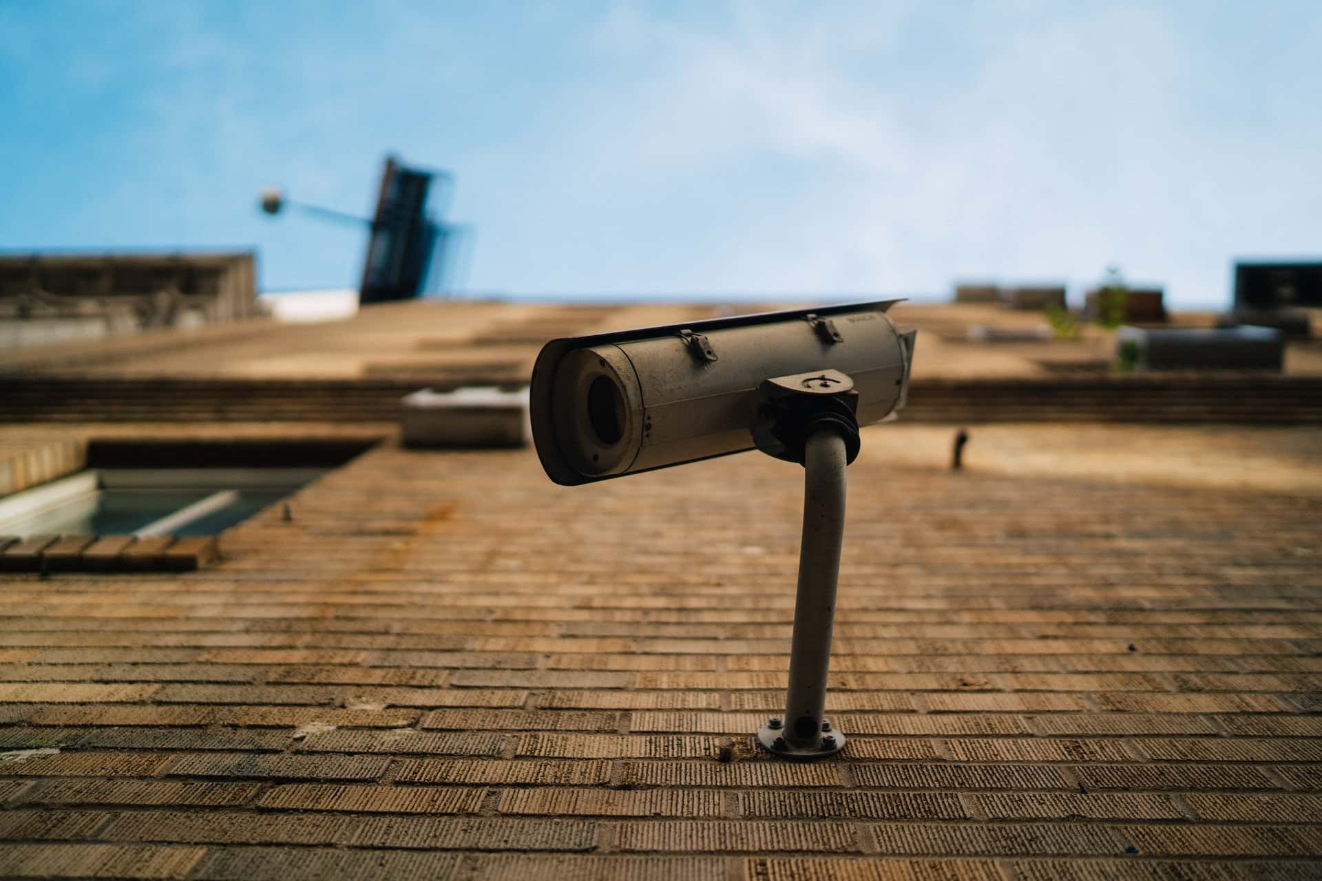 An image showing a cctv camera attached to a property that is remaining compliant with CCTV laws.