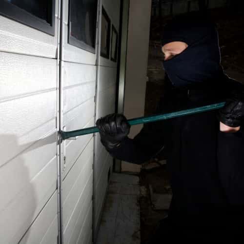 an intruder trying to enter a home in Northampton